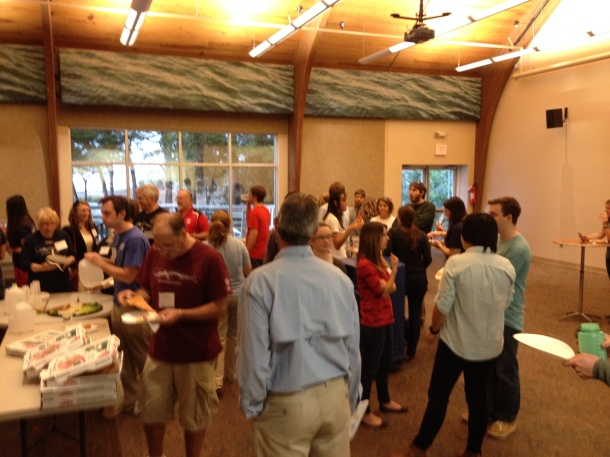 A crowd of scientists gathers for free pizza before the event