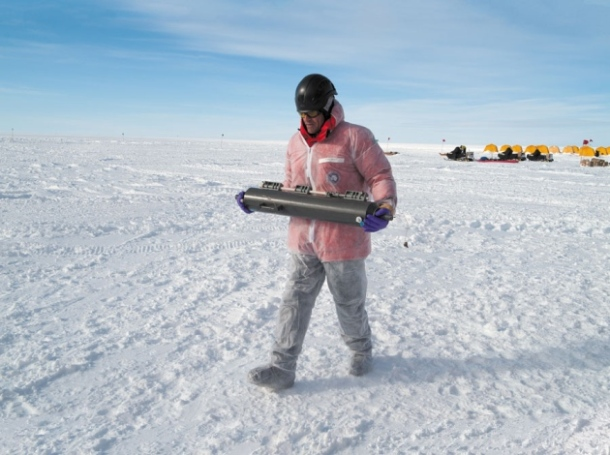 A researcher carries a recently extracted sample of Lake Whillans water. Photo credit: J.T Thomas, from http://www.nature.com/news/lakes-under-the-ice-antarctica-s-secret-garden-1.15729