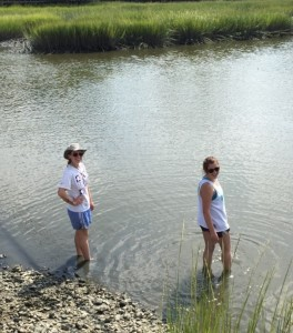 Madeleine Denton (right) preparing to wade into the musk to gather her supply of oysters PC: Abbey Vinson