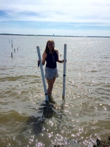 Kelsey Barnhill getting ready to launch her tide gauges. Beware of the stingrays found in that water! PC: Abbey Vinson