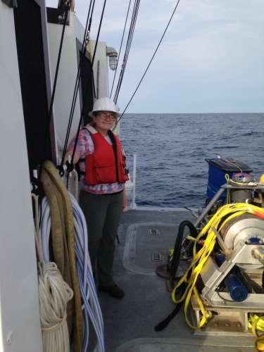 Megan at sea, modeling the finest in construction site chic. She was participating in a cruise to retrieve and redeploy an oceanographic sampling instrument. Photo by Harvey Seim.