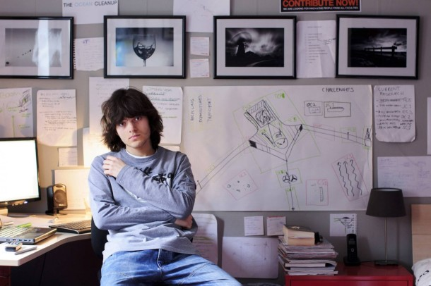 Boyan Slat, in what I'm guessing is his office. Note that his poster says CHALLENGES; how strategic IS this kid?! Image from https://www.washingtonpost.com/news/inspired-life/wp/2016/02/01/can-the-largest-cleanup-in-history-save-the-ocean/